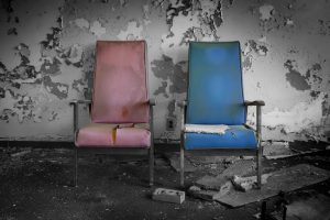 Torn up chairs in dilapidated room